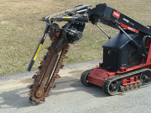 Skidsteer, Mini Dingo Attachment Trencher Image