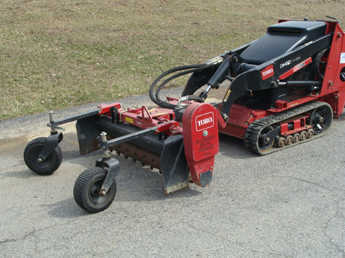 Skidsteer, Mini Dingo Attachment Power Rake Image