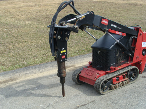 Skidsteer, Mini Dingo Attachment Demo Hammer Image