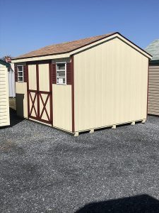 tan shed with red trim