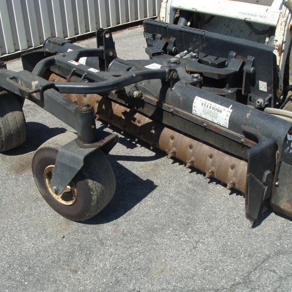 Skidsteer Attachment, Power Box Rake Image