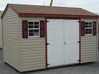 grey shed with white doors