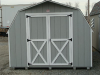 grey barn shed with white trim