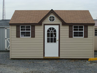 tan shed with white door