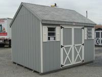 grey shed with white trim