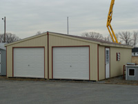 yellow double garage with red trim