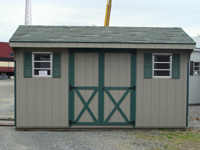 grey shed with green trim