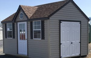 tan shed with white doors