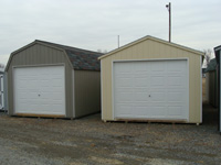 tan & grey garage with white doors